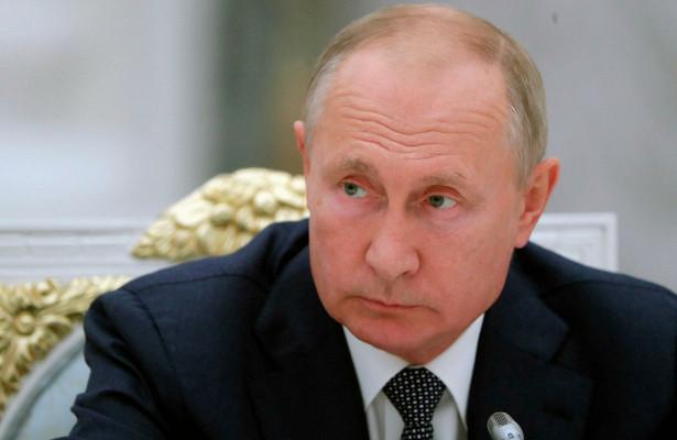 Путин возложил цветы кмогиле Ланового