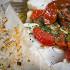 Ресторан Boston Seafood & Bar - фотография 4 - Треска, запеченная в пергаменте с овощами