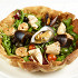 Ресторан Де Марко - фотография 7 - Салат с морепродуктами на фокаччо, под соусом «Цитронет»